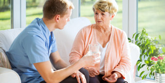 senior woman and caregiver having a conversation