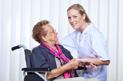 nurse and an old woman in a wheelchair